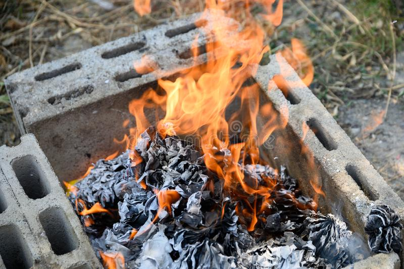 Burning paper for faith to the ancestors in chinese new year royalty free stock image