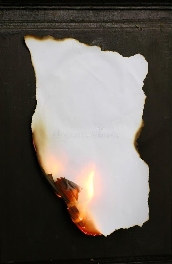 burning papper fotografering för bildbyråer