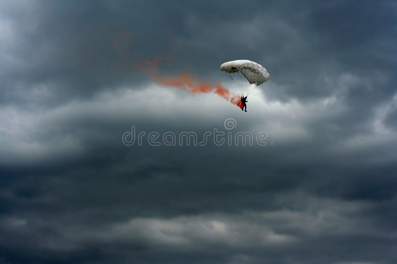Burning parachute stock images