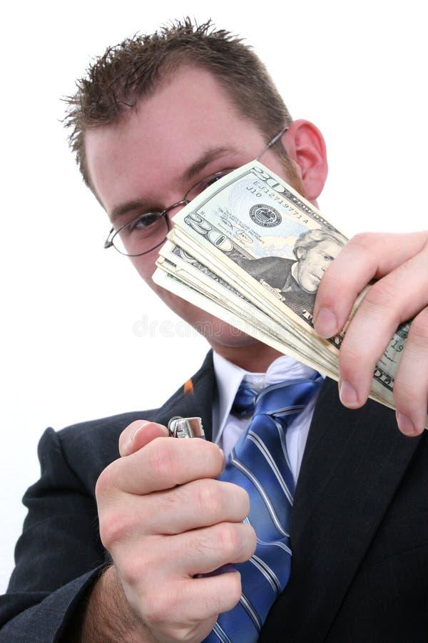 Burning Pengar För Affärsman Arkivbild