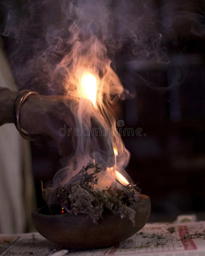Burning plant material in traditional medicine royalty free stock photos
