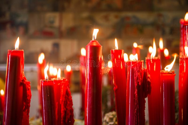 Burning red candle in chinese temple royalty free stock images