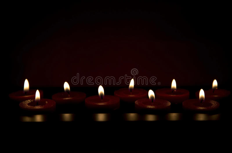 Burning red candles stock photography