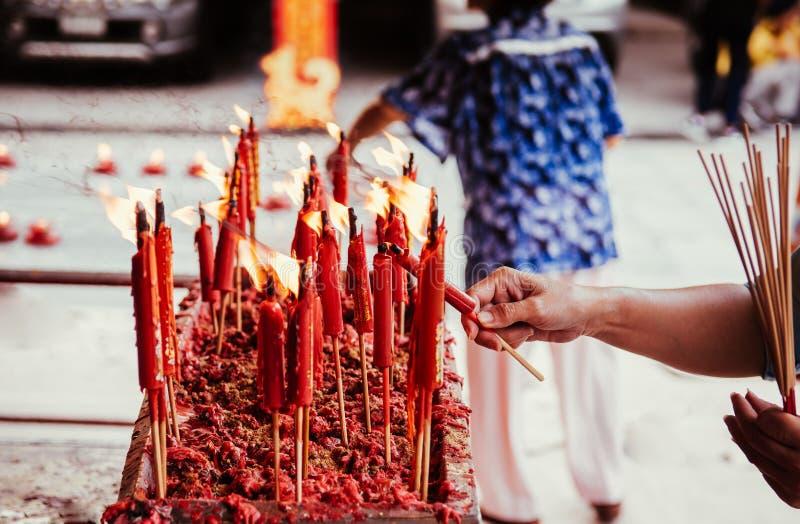 Burning red chinese candle at Wat Mangkon Kamalawat famous Chine royalty free stock photos