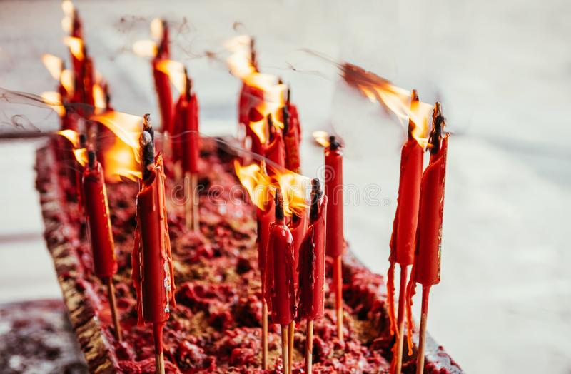 Burning red chinese candle at Wat Mangkon Kamalawat famous Chine stock photography