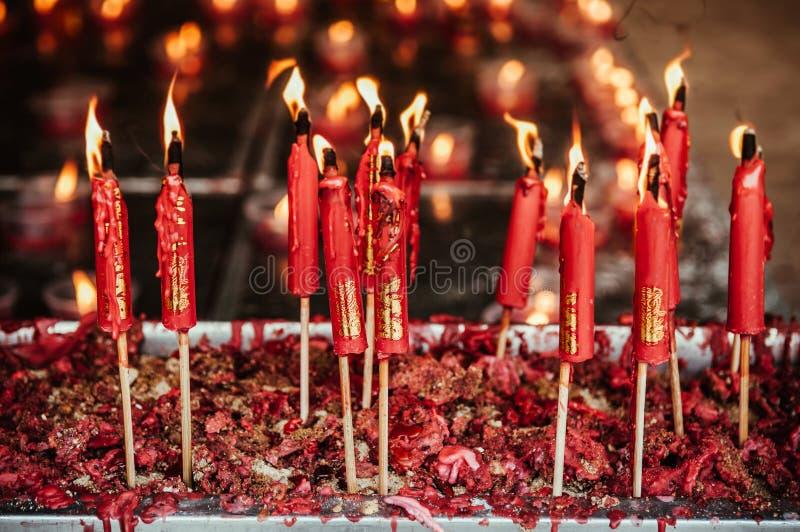 Burning red chinese candle at Wat Mangkon Kamalawat famous Chine stock image