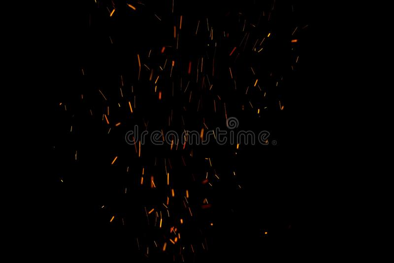 Burning red hot sparks fly from large fire in the night sky. Beautiful abstract background on the theme of fire, light and life. Burning red hot sparks fly from royalty free stock photos