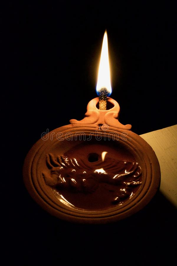 Burning Roman Oil Lamp stock photography