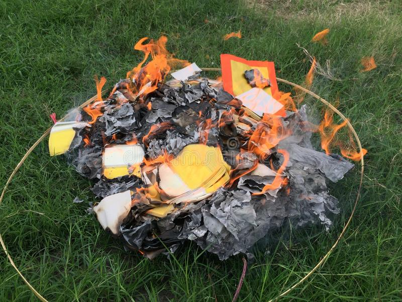 Burning Silver and gold paper and hat to worship ancestor in Chinese culture royalty free stock photos