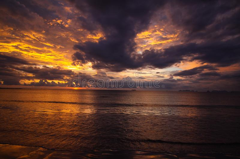 Burning sky and sea during sunset over the ocean of tropical island Ko Lanta, Andaman Sea, Thailand royalty free stock photos