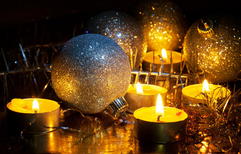 Burning small candles and Christmas tree decorations royalty free stock photo