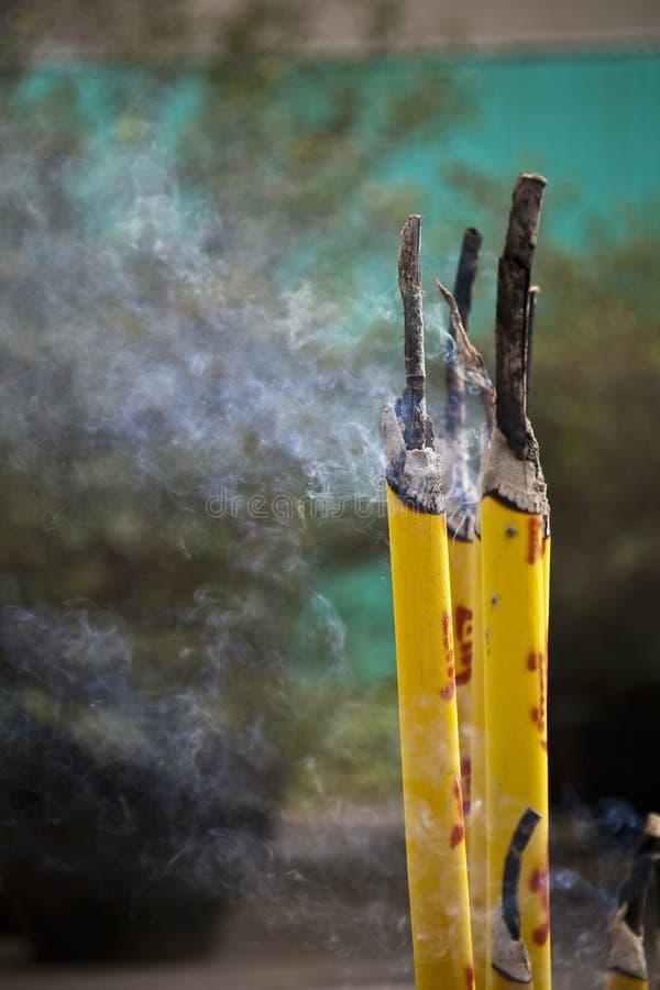 Burning smokey incense sticks stock photography