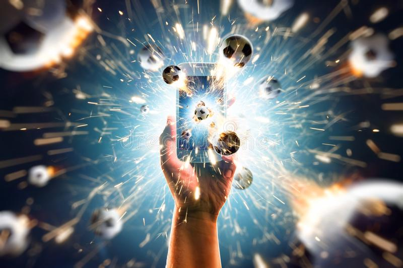 Burning soccer balls flies from the smartphone stock images