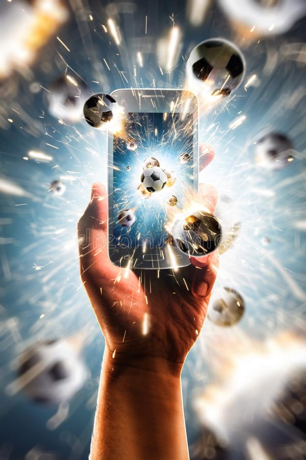 Burning soccer balls flies from the smartphone royalty free stock photography