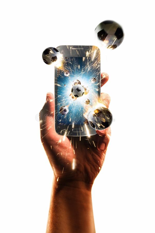Burning soccer balls flies from the smartphone, white isolated royalty free stock photo