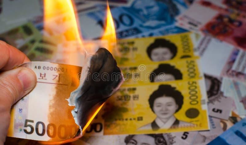 Burning South Korean won royalty free stock photos