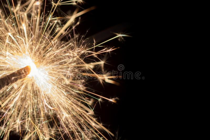 Sparkler in front of black background with copy space stock photos