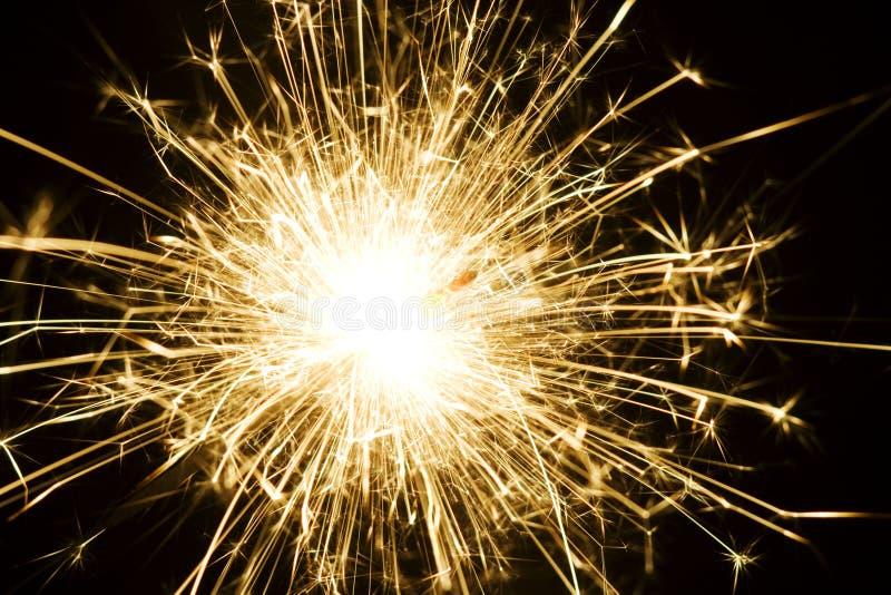 Burning sparkler firework. With black background stock photography