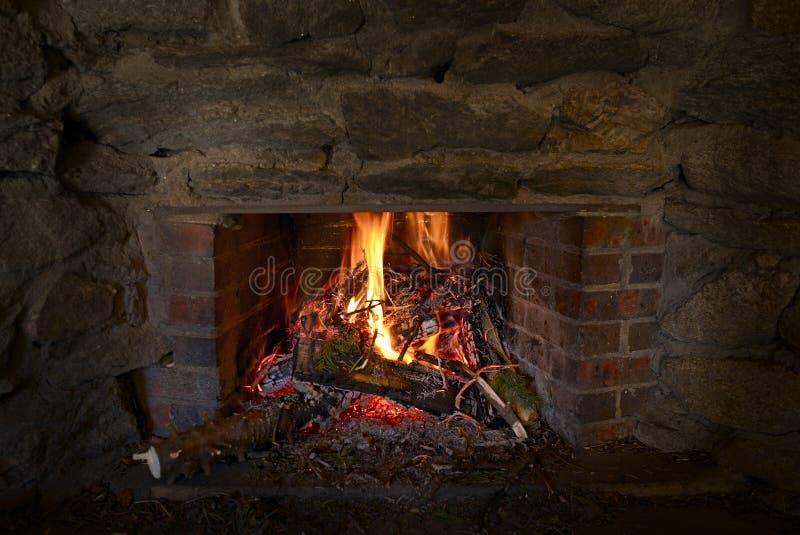 Burning Stone Fireplace. Burning Wood in Stone Fireplace. Fireplace Closeup stock photography