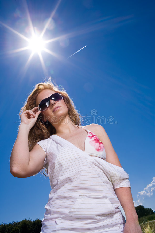 Burning sun with woman royalty free stock image