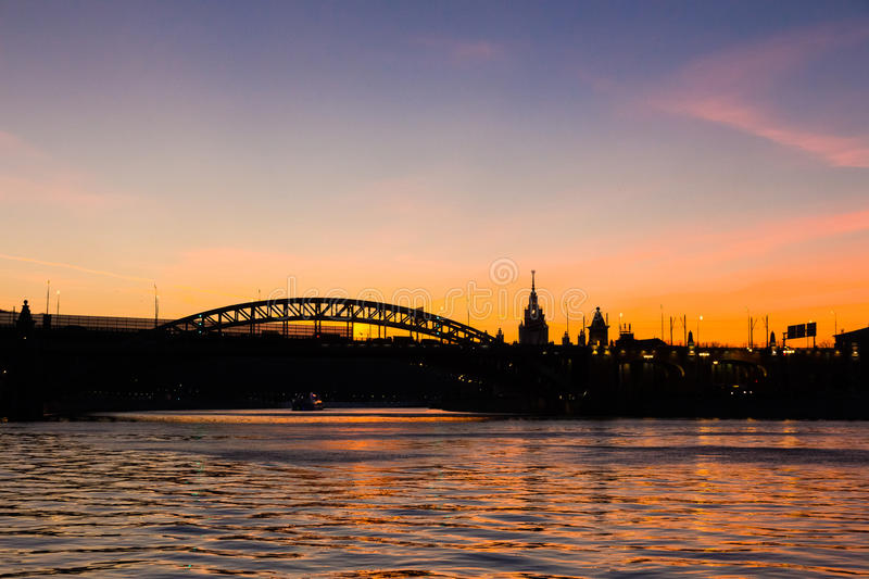 Burning sunset at the Moscow river embankment stock images