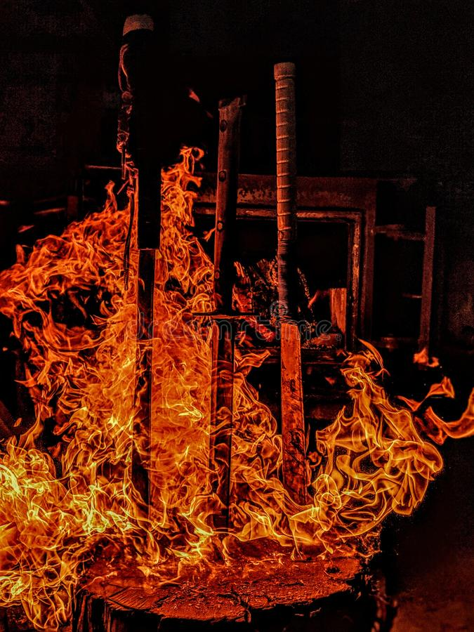 Burning swords. Enjoy the view of the fireball wrapping around all the home made swords stock images