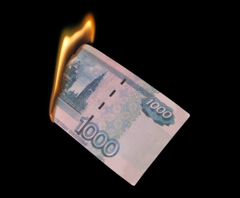 Burning thousand rubles royalty free stock photography