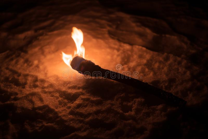 Burning torch in the cold winter stock photography