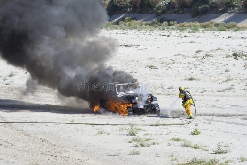 Burning Vehicle. A vehicle burning in a wash near Palm Desert, California royalty free stock photo