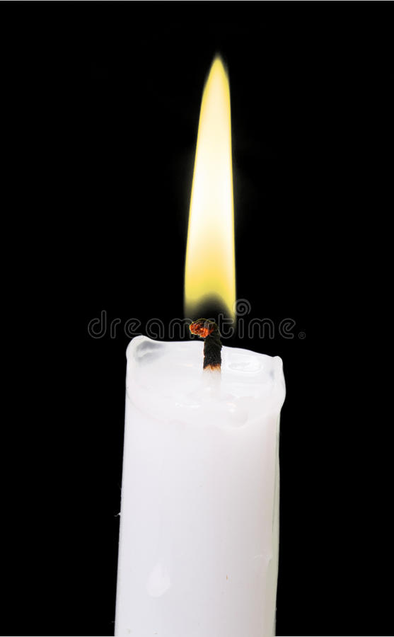 Burning votive candle close up. Candle with flame close up stock photos