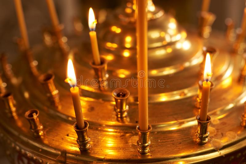 Burning wax candle in the Church. For all purposes stock images