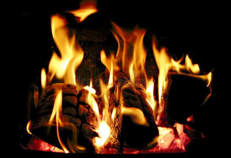 Burning wood. Wood burning inside a fireplace royalty free stock photos