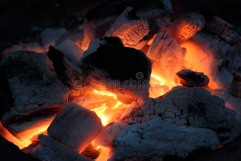 Burning the wood charcoal stock images
