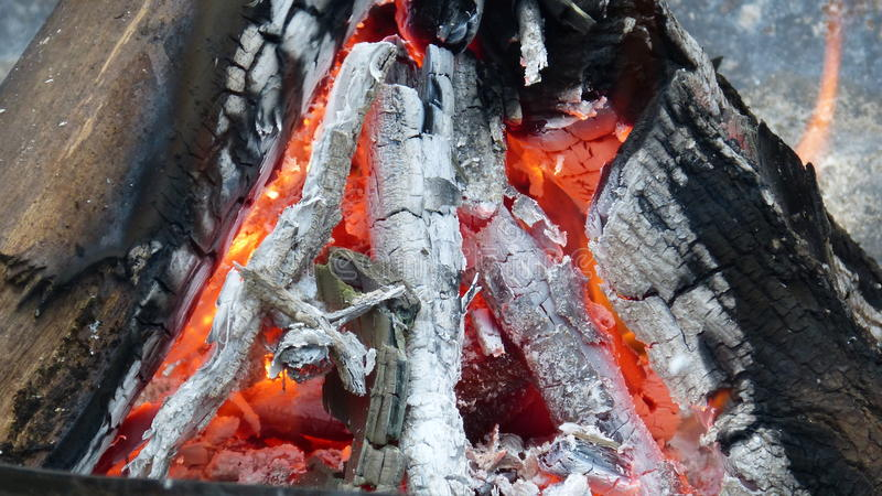Burning Wood in the Fall. Keeping warm on a crisp Fall evening with a warm fire stock photo