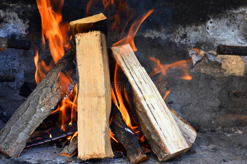 Burning wood royalty free stock photography