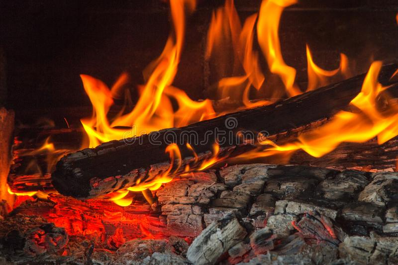 Burning wood at night. Flame and fire sparks on dark abstract background. Cooking barbecue outdoor. Burning wood at night. Flame and fire sparks on dark royalty free stock image
