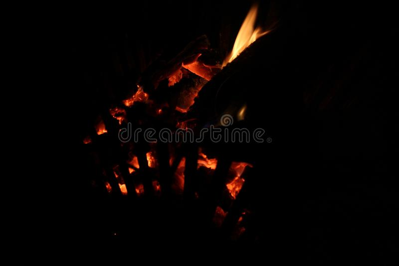 Fire Pit Evenings. The burning wood of one of many evenings spent around the fire pit stock images