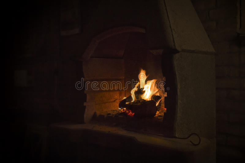 Burning wood in open fire place stock images