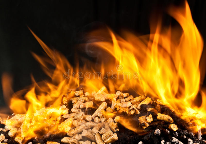 Burning wood pellet stock images