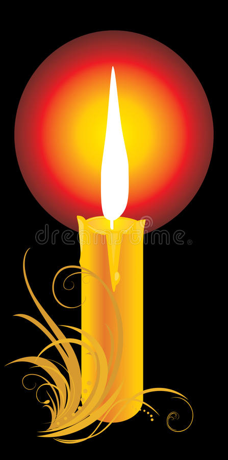 Burning yellow candle with ornament stock images