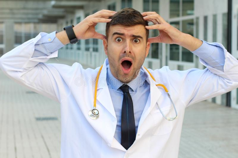 Burnout doctor suffering a stress disorder.  stock photo