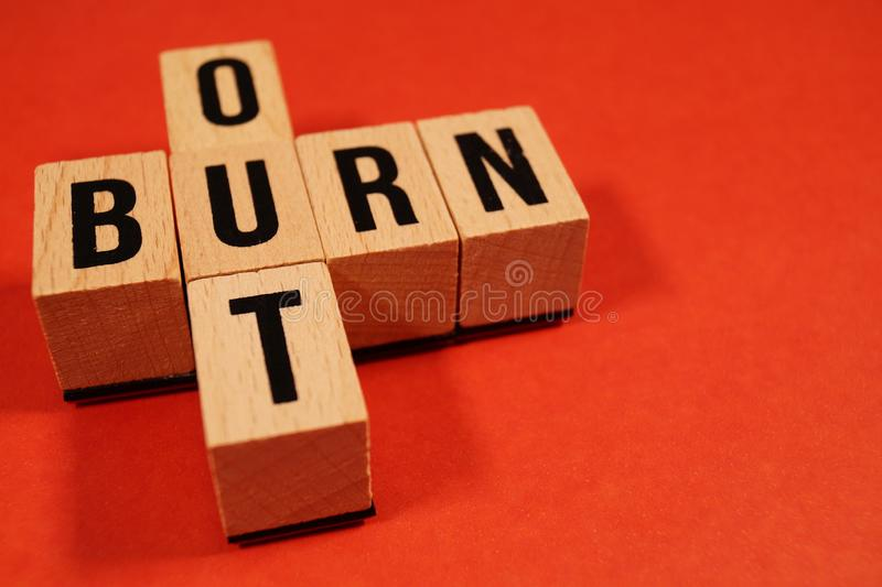Burnout Word Written In Wooden Cube. Burn out, cube with letters. dice with text. concept of the destruction of shortcomings, fear. Burnout at work, daily stock image