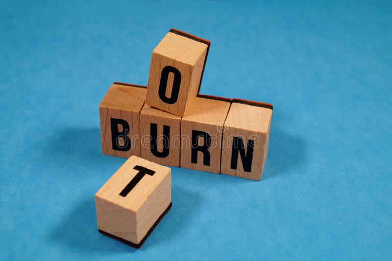 Burnout Word Written In Wooden Cube. Burn out, cube with letters. dice with text. concept of the destruction of shortcomings, fear. Burnout at work, daily stock images