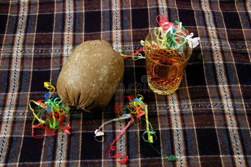 Burns Night. Haggis with nip of Whisky on a Tartan. stock image