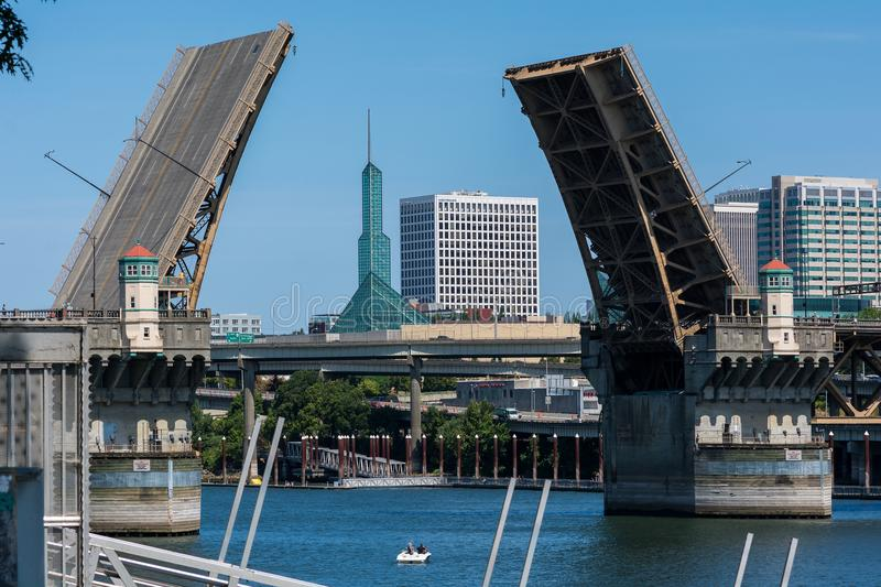 Open draw bridge in the city. Burnside Bridge opened over the Willamette River, revealing the Oregon Convention Center in Portland, Oregon royalty free stock photo