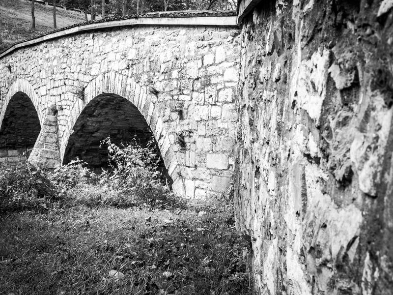 Burnside Bridge with Two Arches and Angled Wall. Burnside Bridge showing two of three arches and shallow depth of field on angled wall stock photos