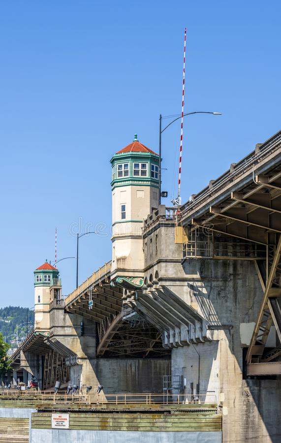 Burnside buscle Bridge with towers in Portland Down Town. Wide truss Burnside drawbridge over the Willamette River in down town of Portland Oregon with towers on stock image