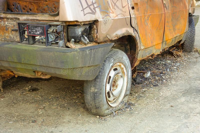Burnt, abandoned passenger car close-up. Russia royalty free stock image