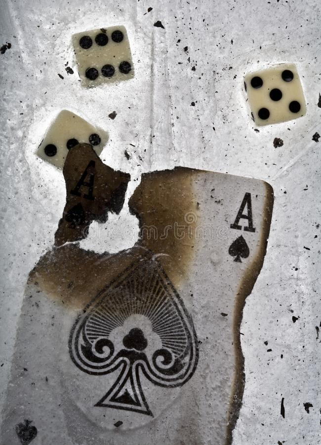 Burnt ace of spades and dices in ice stock image