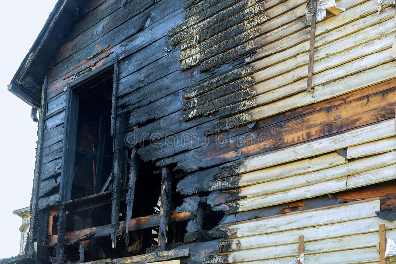 Fire line in front of a destroyed home. burnt house after fire stock image